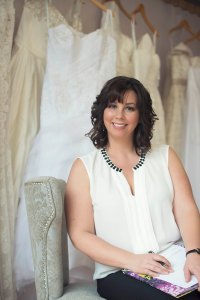 Picture of Morgan, the owner of The Valley Bride bridal shop, sitting in a chair.